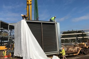 Victory economizer being unwrapped and prepped for rigging